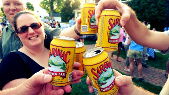 friends drinking cans of saranac beer